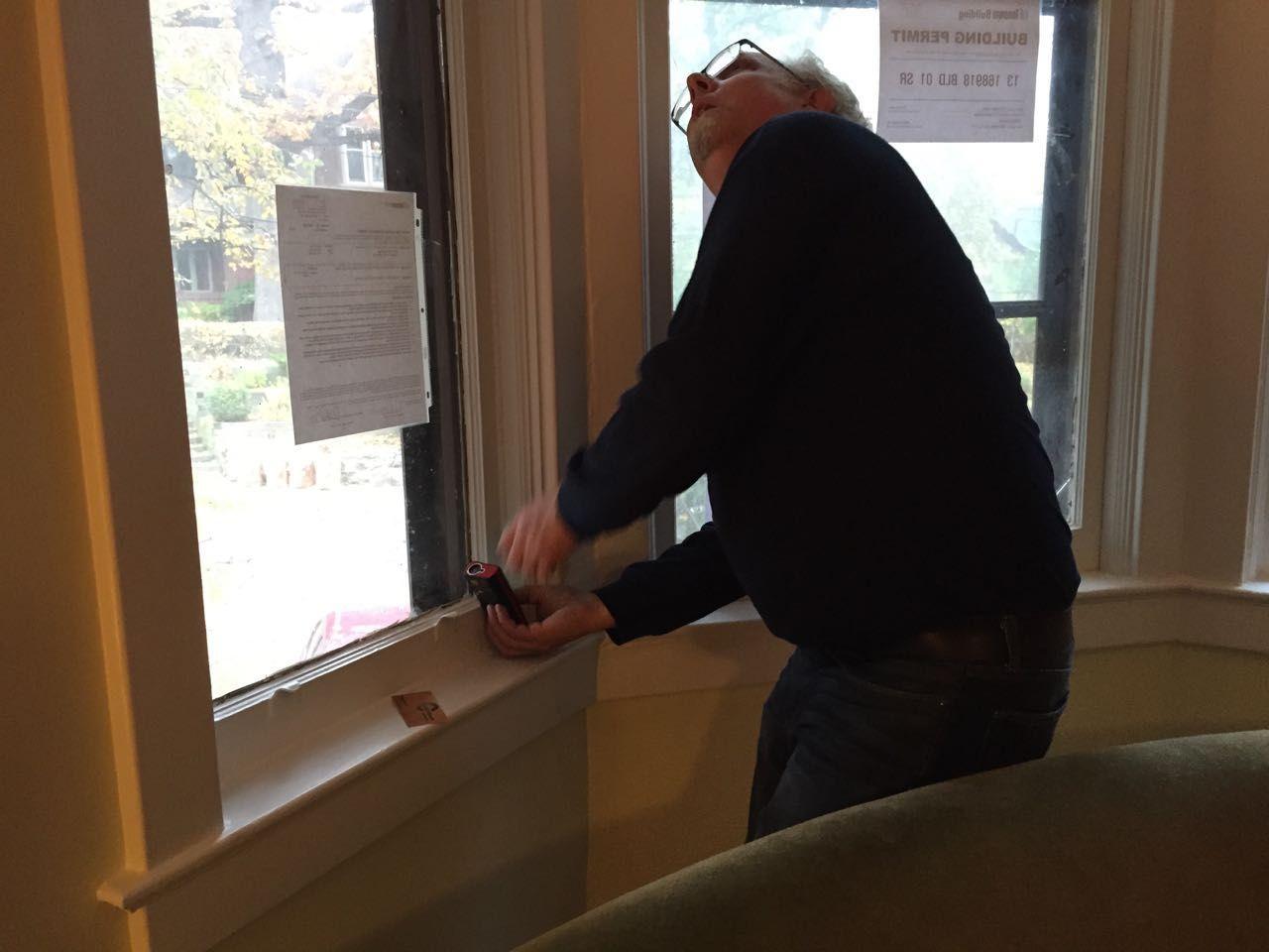 Man measuring a bay window