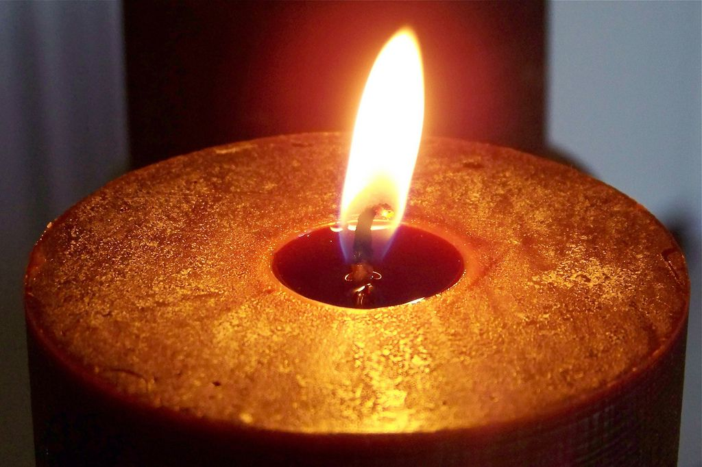candle wick in melted wax