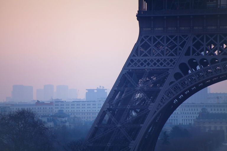 close up of Eiffel tower, pollution in Paris, France