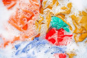 Colorful clothes in sudsy water