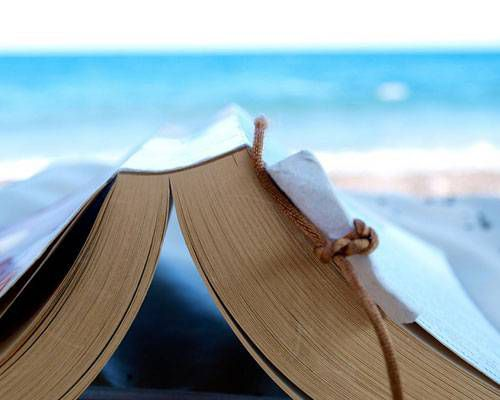 A book laying in the sand