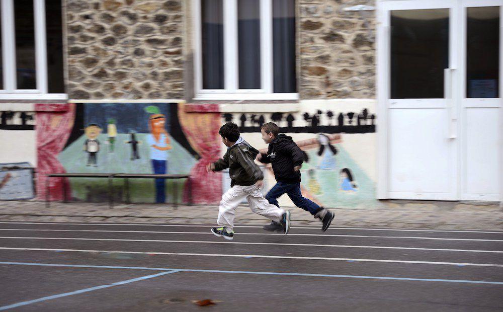 Running in Parisian schoolyard