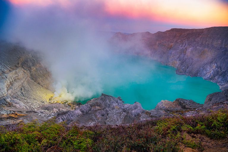 The turquoise water of Kawah Ijen at sunset