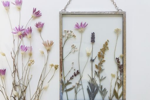 Framed pressed flowers in tiffany technique in stained glass