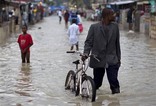 People walking in a flooded town