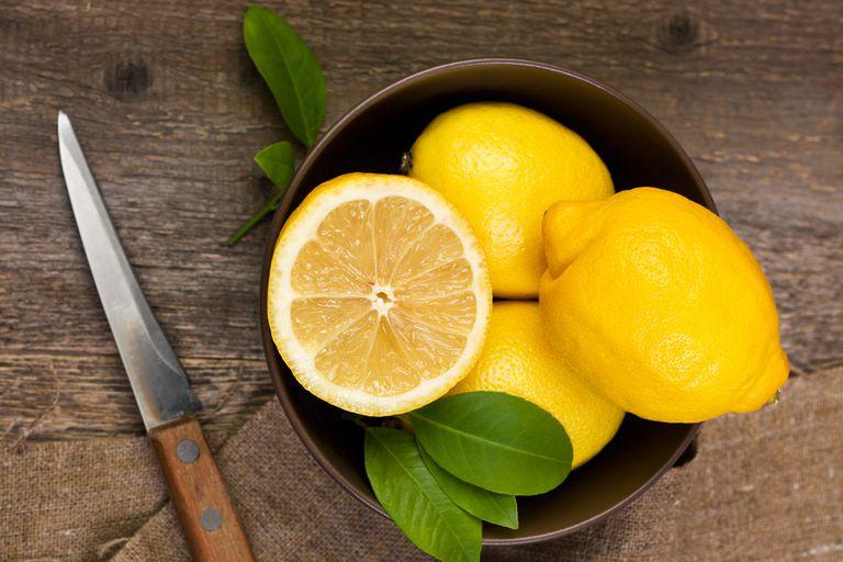 bowl of sliced lemons - lemons can help heal itchy scalp