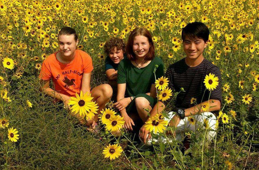Kids in a field of flowers.