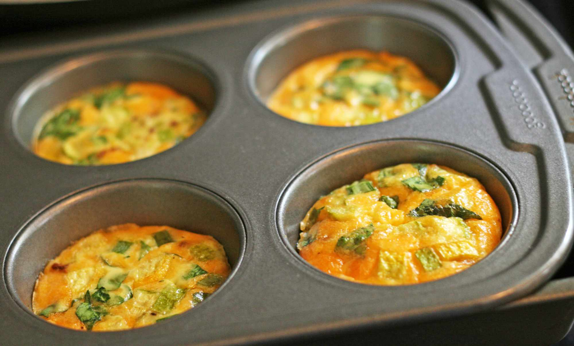 Crustless quiche in muffin tin right out of the oven