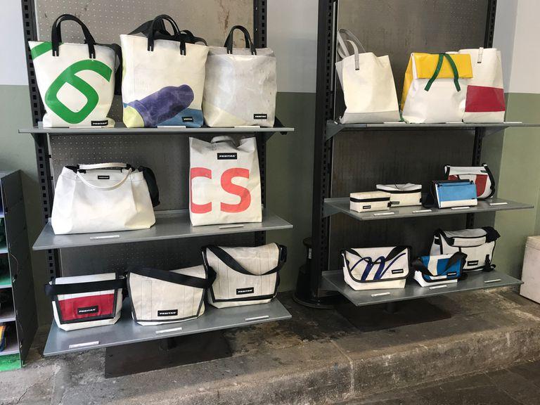 Freitag bags on display on six shelves