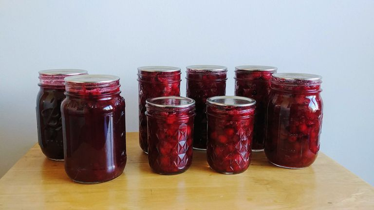 Jars of fruits on a wooden table