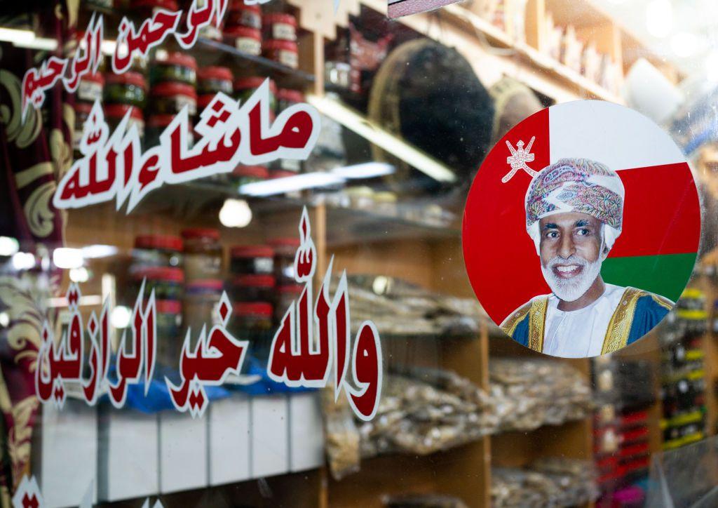 Sultan qaboos sticker on a window shop