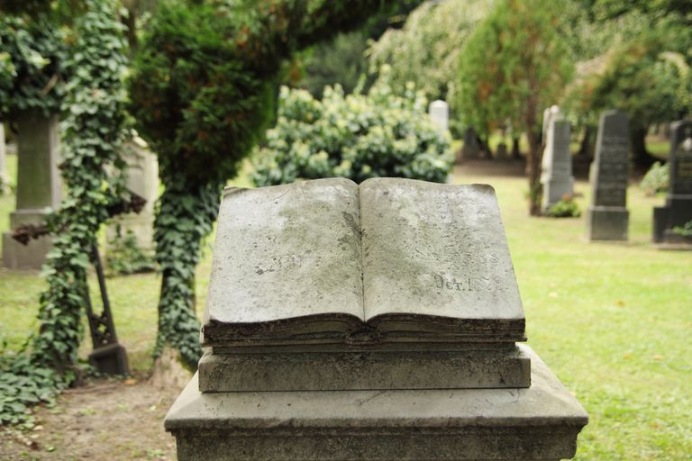 Grave marker sculpted to look like an open book
