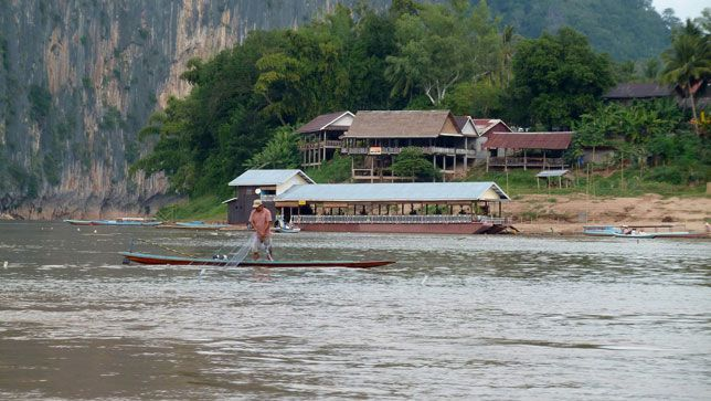 A man fishes in the Mekong River in Laos