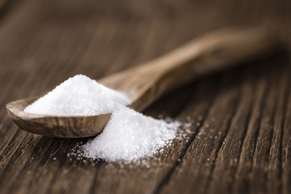 spoonful of white refined sugar