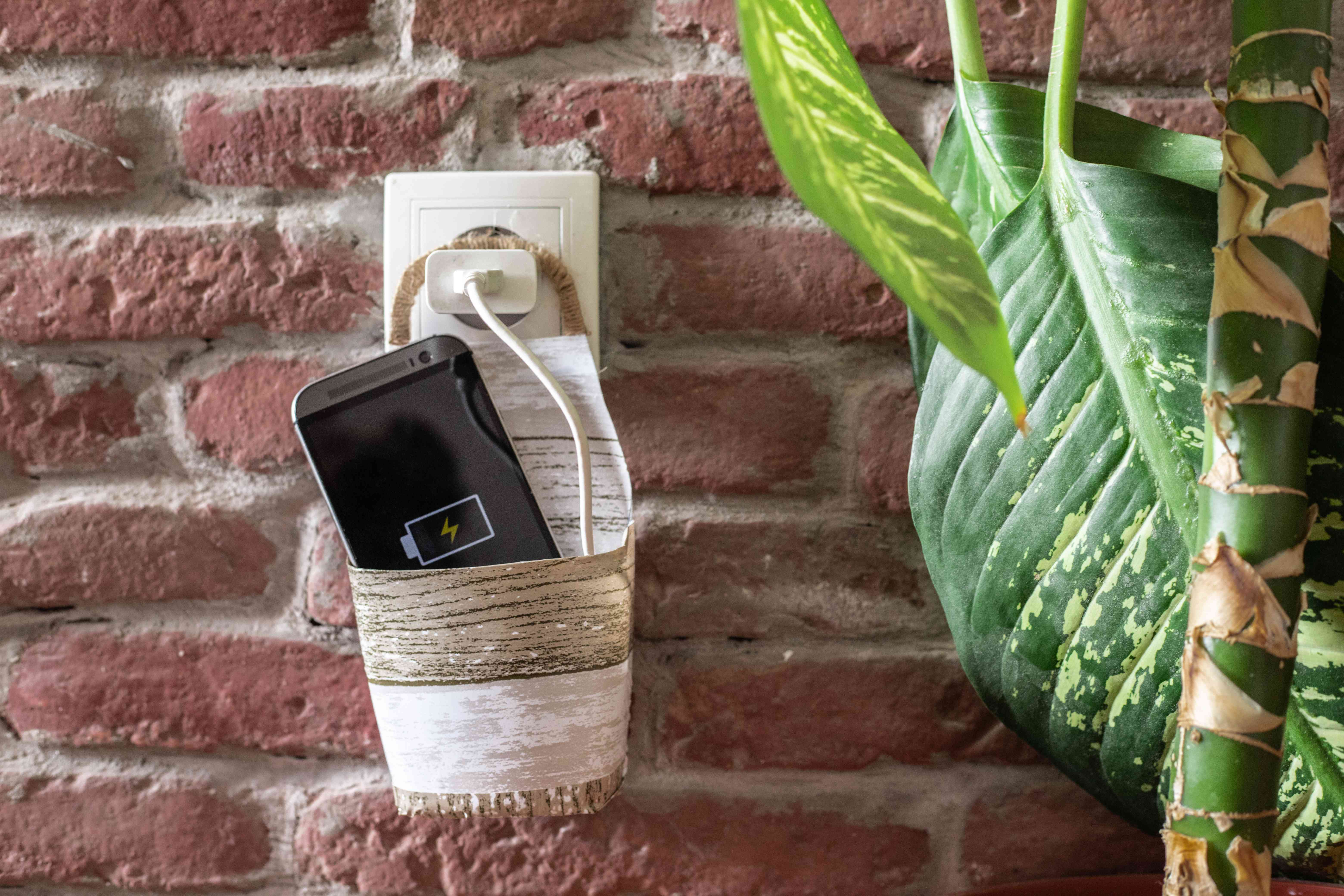 recycled plastic bottle upcycled into cell phone holder for charger