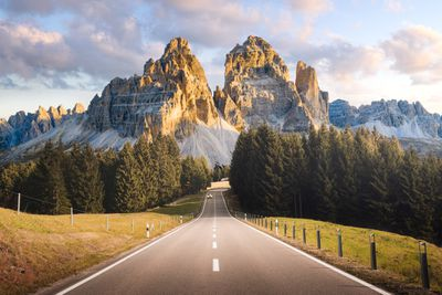A road leads into the Italian Alps