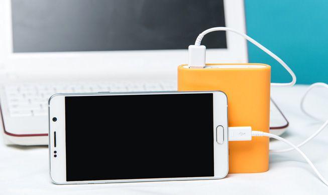A cellphone connected an external battery pack