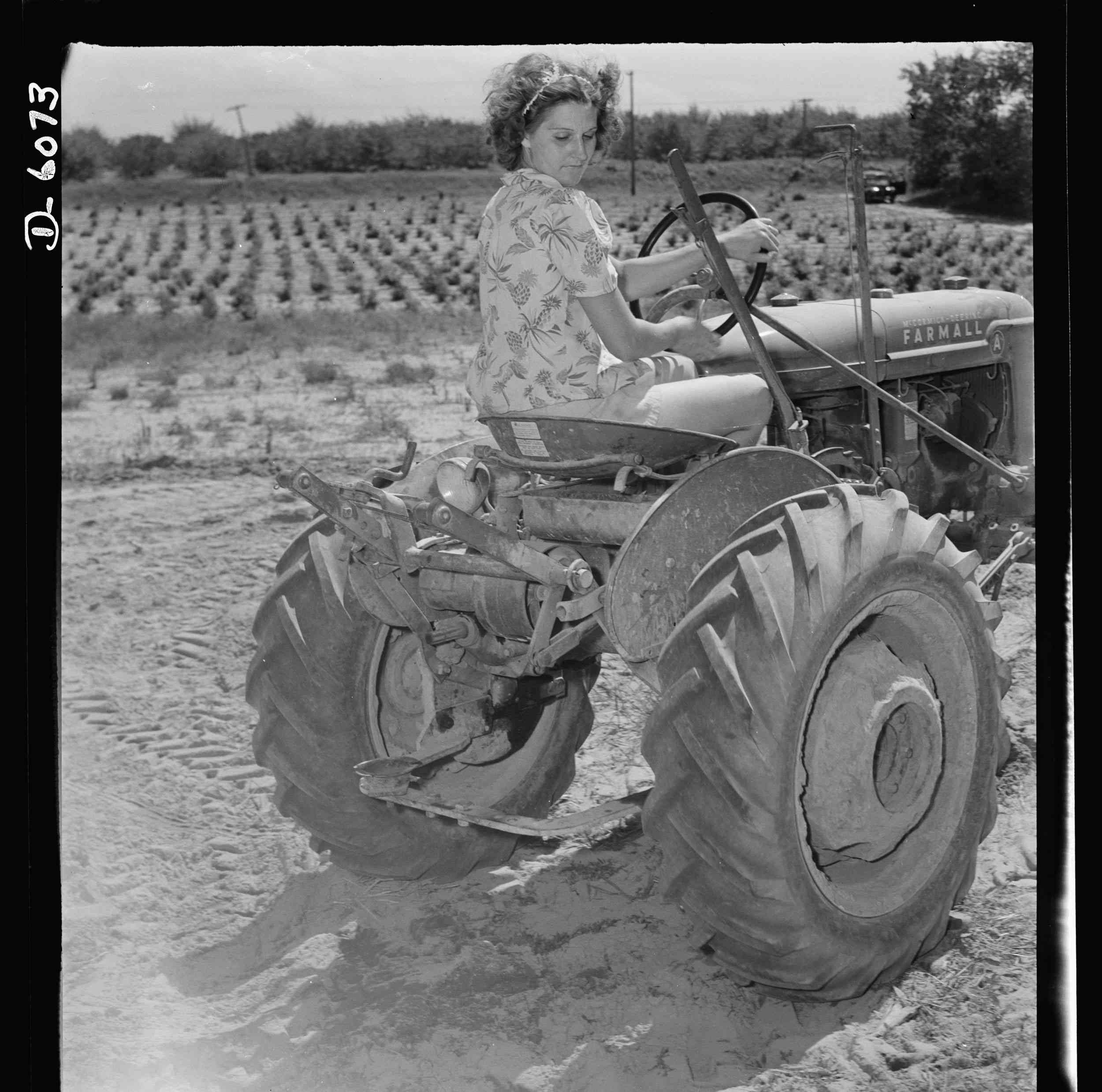 Woman riding a tractor