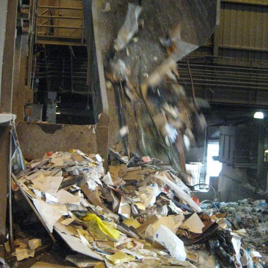Garbage being dumped at a waste facility.