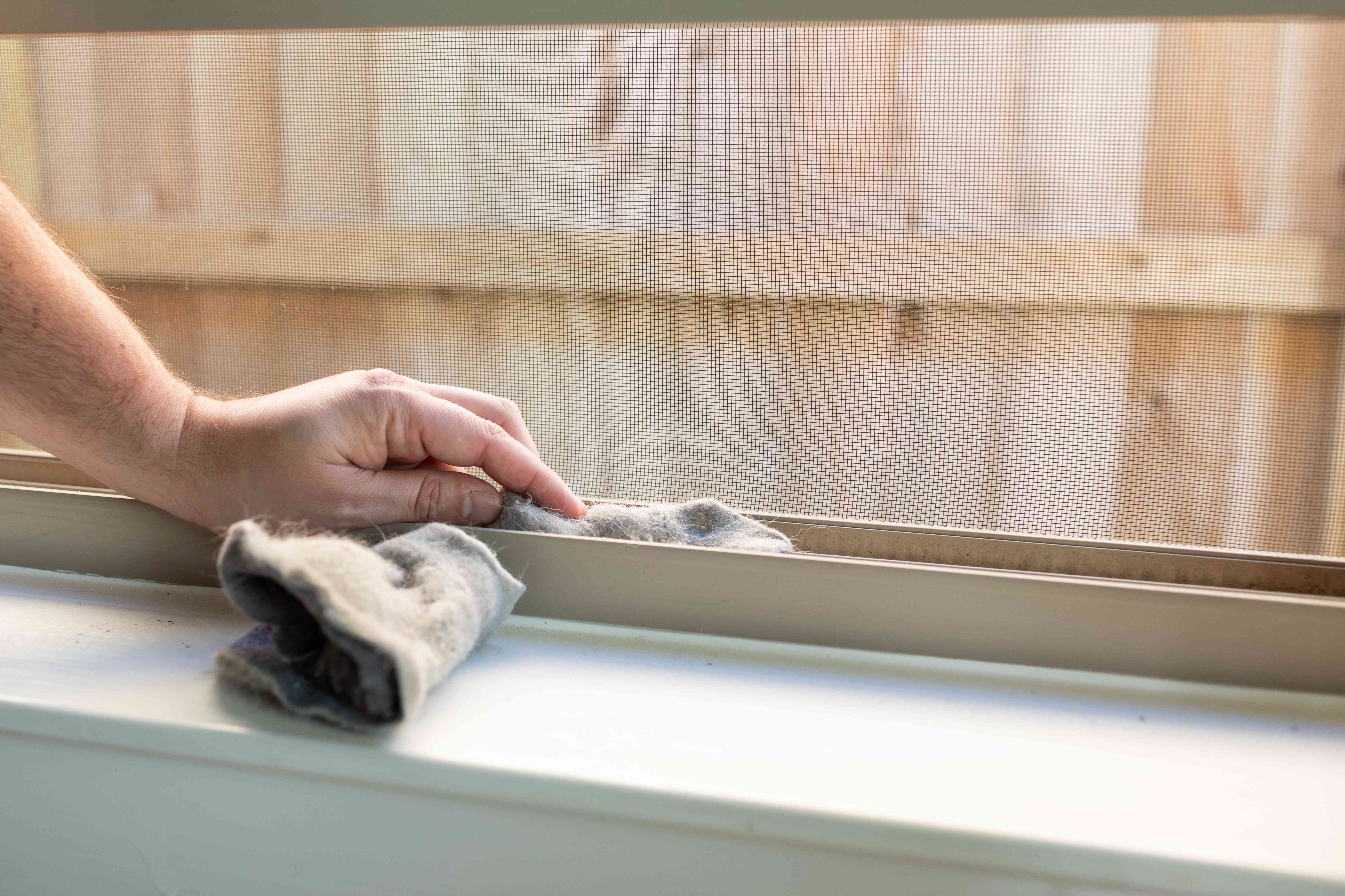 hand tucks used dryer lint into window sills to prevent drafts