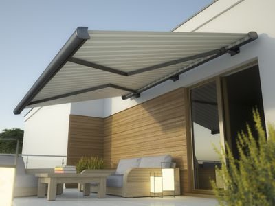 A large gray awning over a glass door and patio