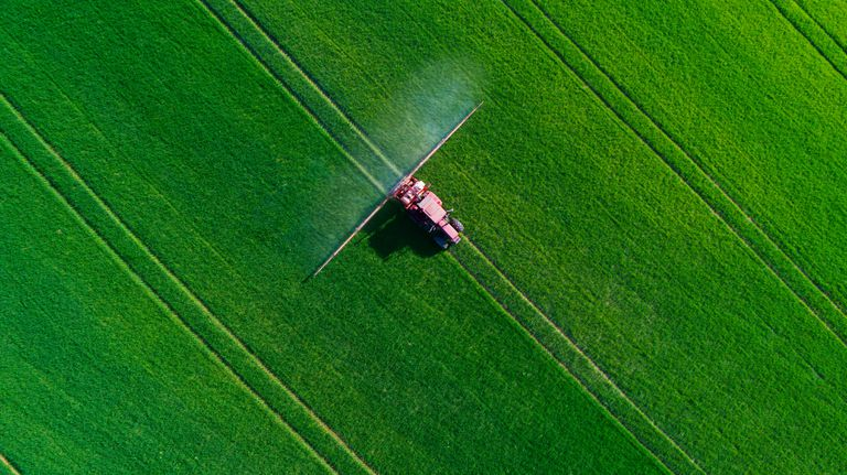 Tractor spraying in a field.