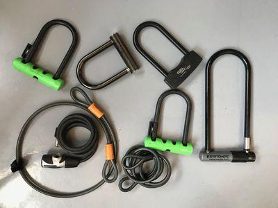 Several bike locks laid side by side