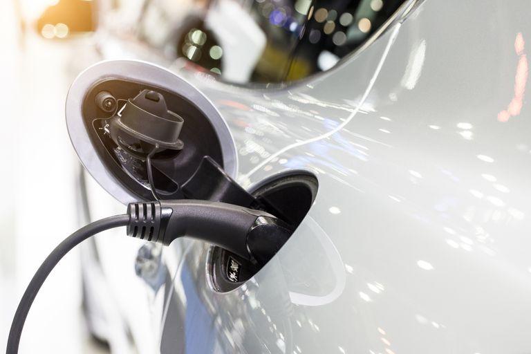 Close up of electric plugin in electric car
