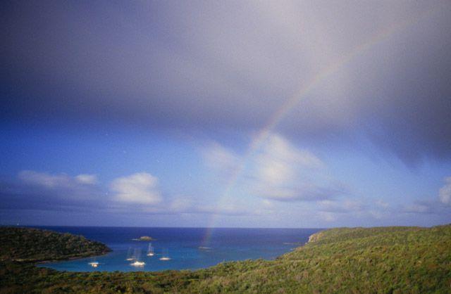 Moonbow with sailboats over St. John, Virgin Islands