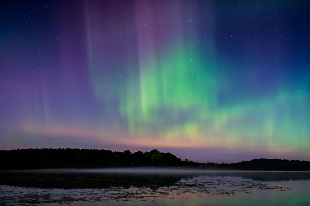 Multicolored northern lights over a lake in Wisconsin