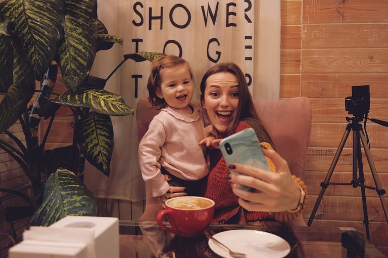 Mother takes selfie with a toddler