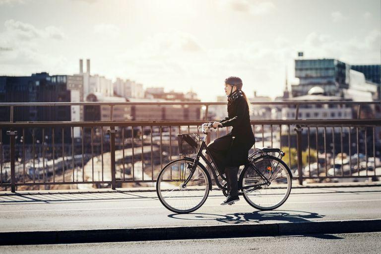 woman riding a bike in city