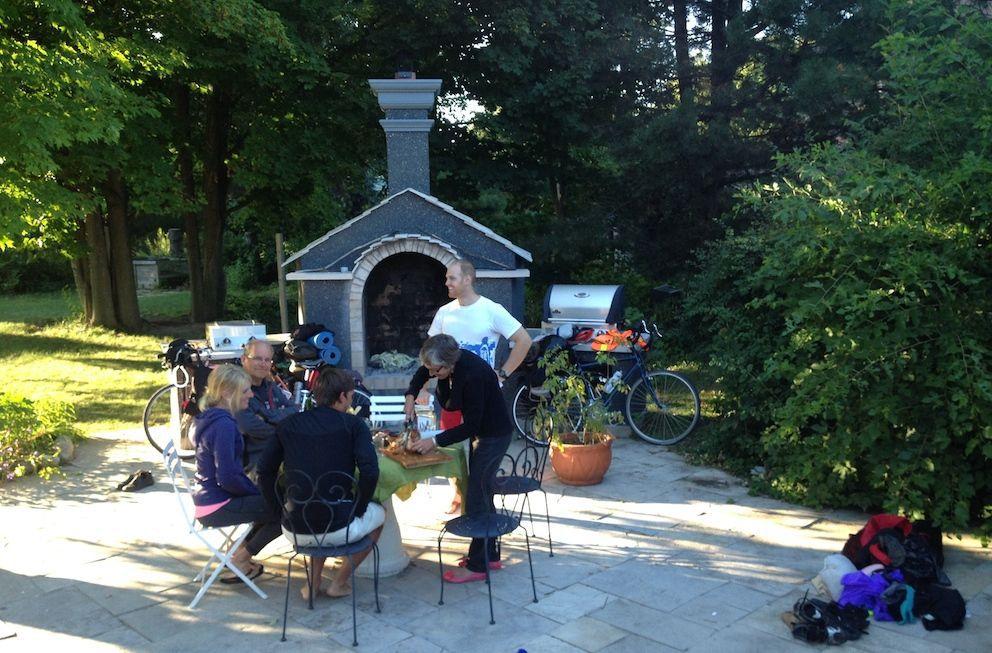 Family having dinner on their backyard patio