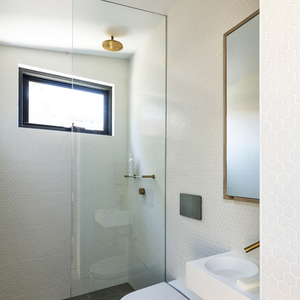 Bathroom with sink, toilet, and shower
