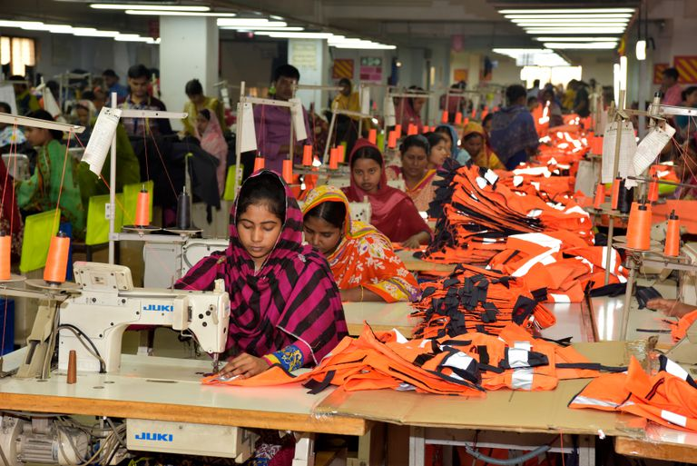 women at sewing machines in a garment factory in Bangladesh