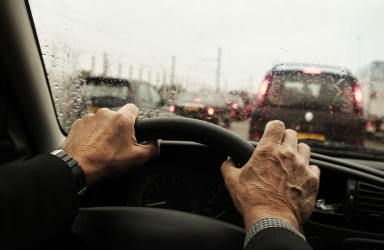 hands on steering wheel in traffic