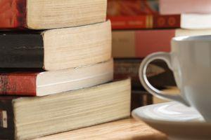 Stack of books and coffee mug