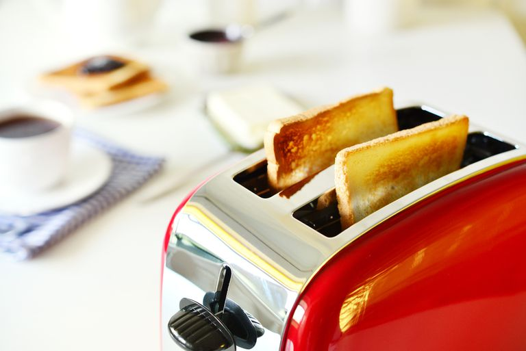 Toaster pops up two pieces of toasted bread