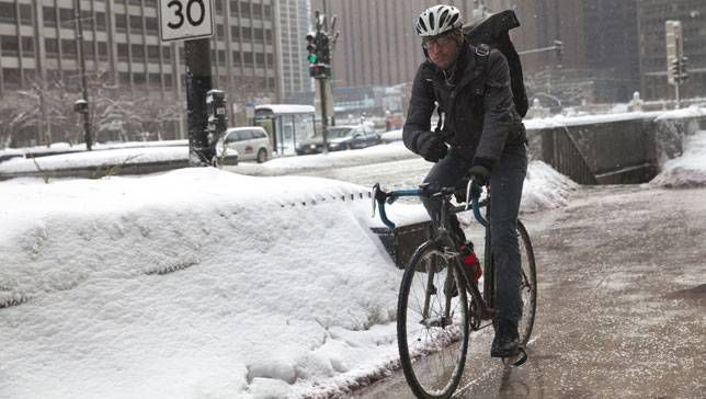 Biker riding bike during a winter in Chicago, Illinois