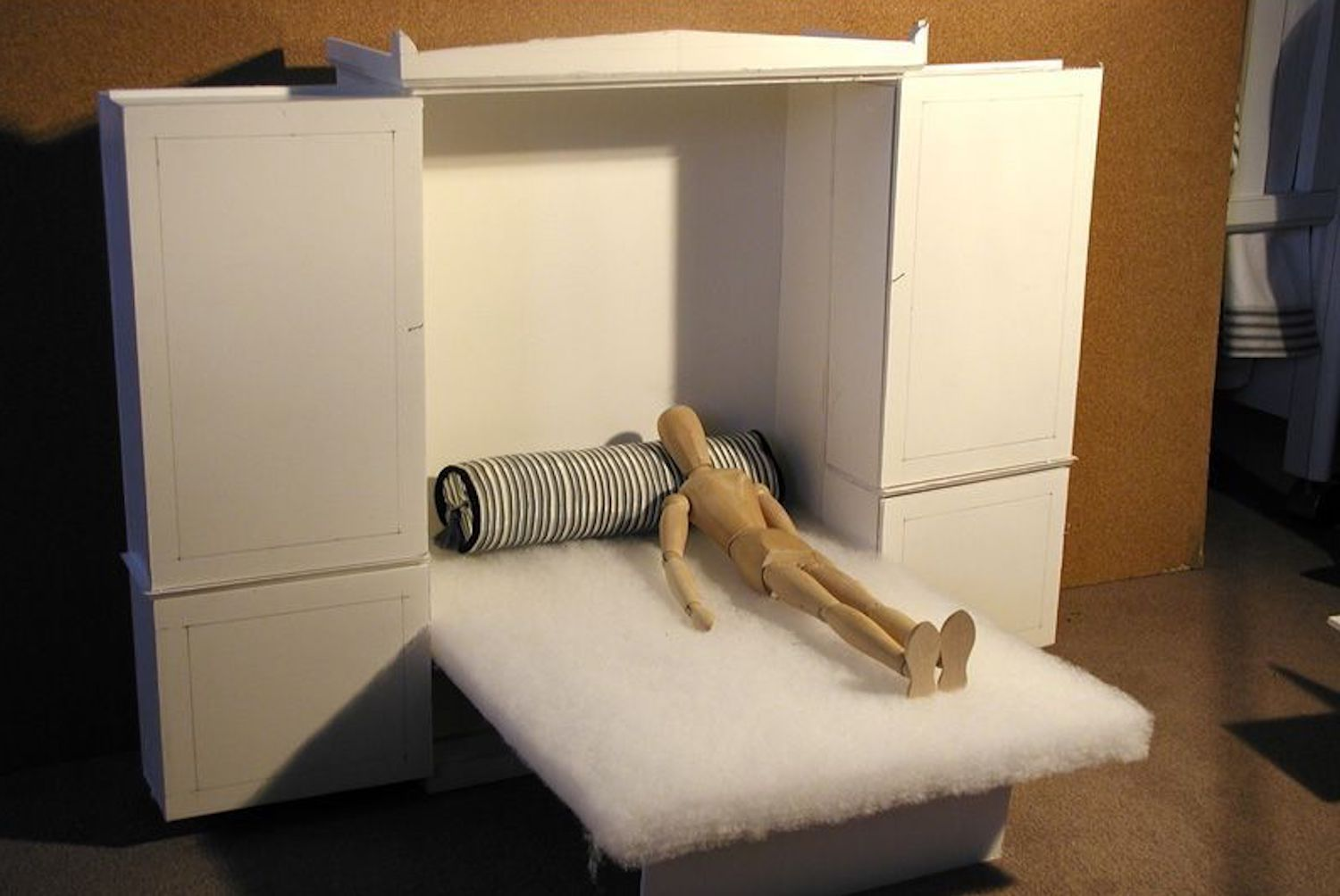 Model of bed folding out of a closet