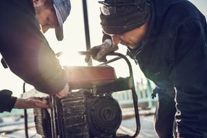 Men turning on a generator