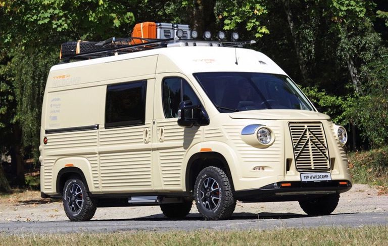 Cream colored van with equipment on top