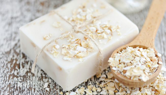 A bar of oatmeal soap and dried oats