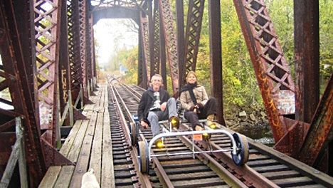 Couple riding the railroad quad
