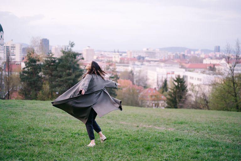 happy woman in city park