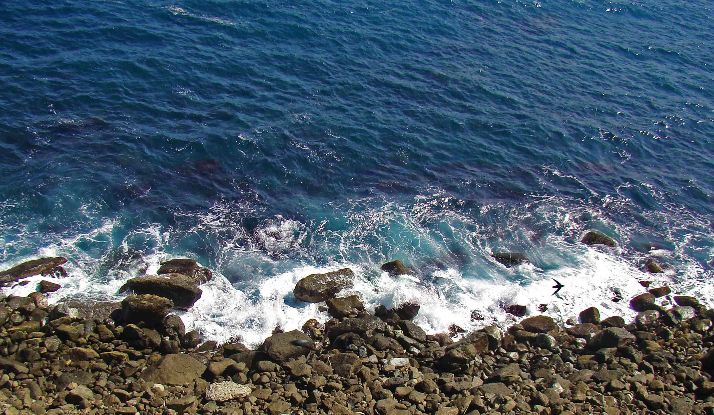 ocean breaks on rocky coast
