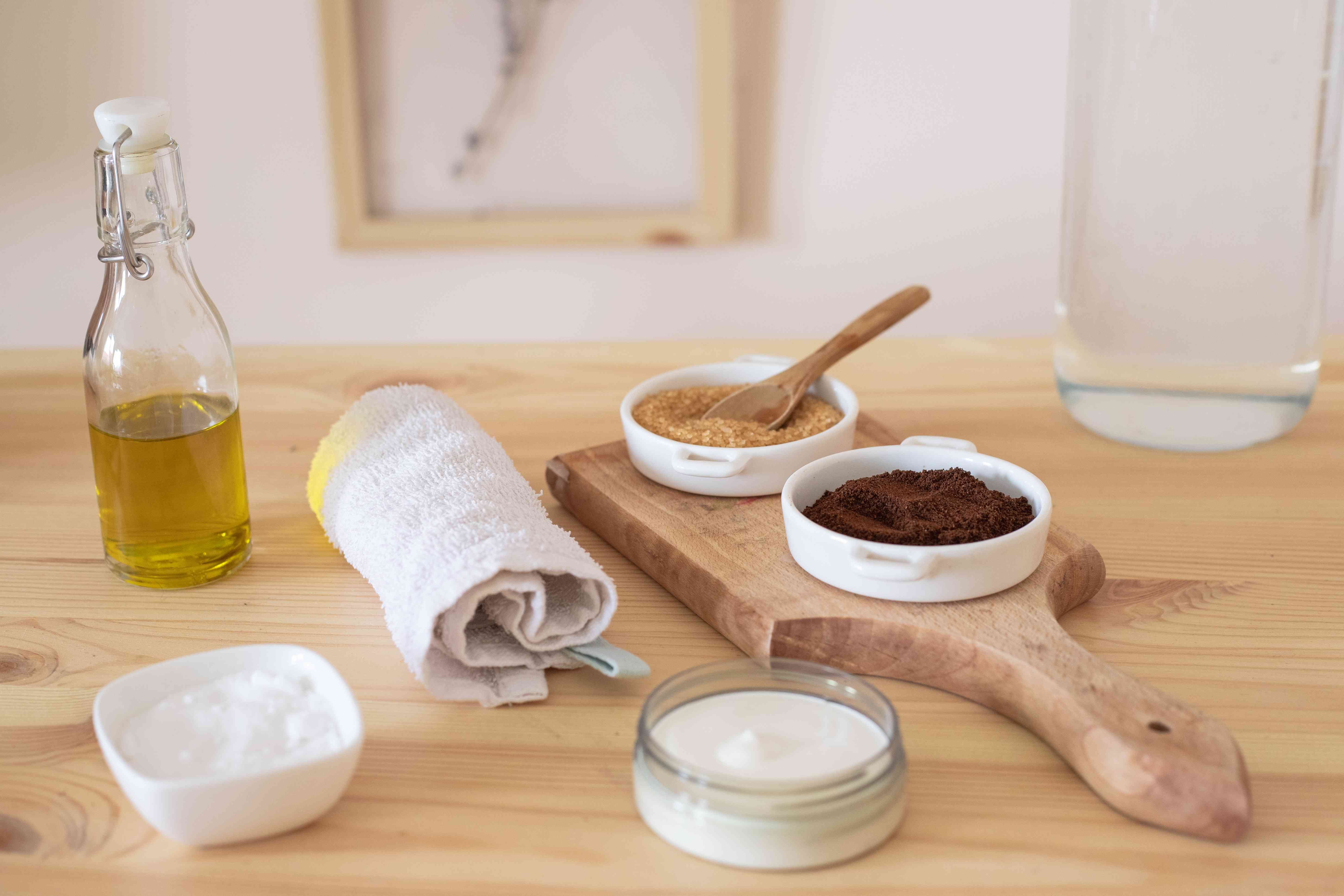 various oils, sugars, coffee grounds, and washcloths for a zero waste facial cleanse