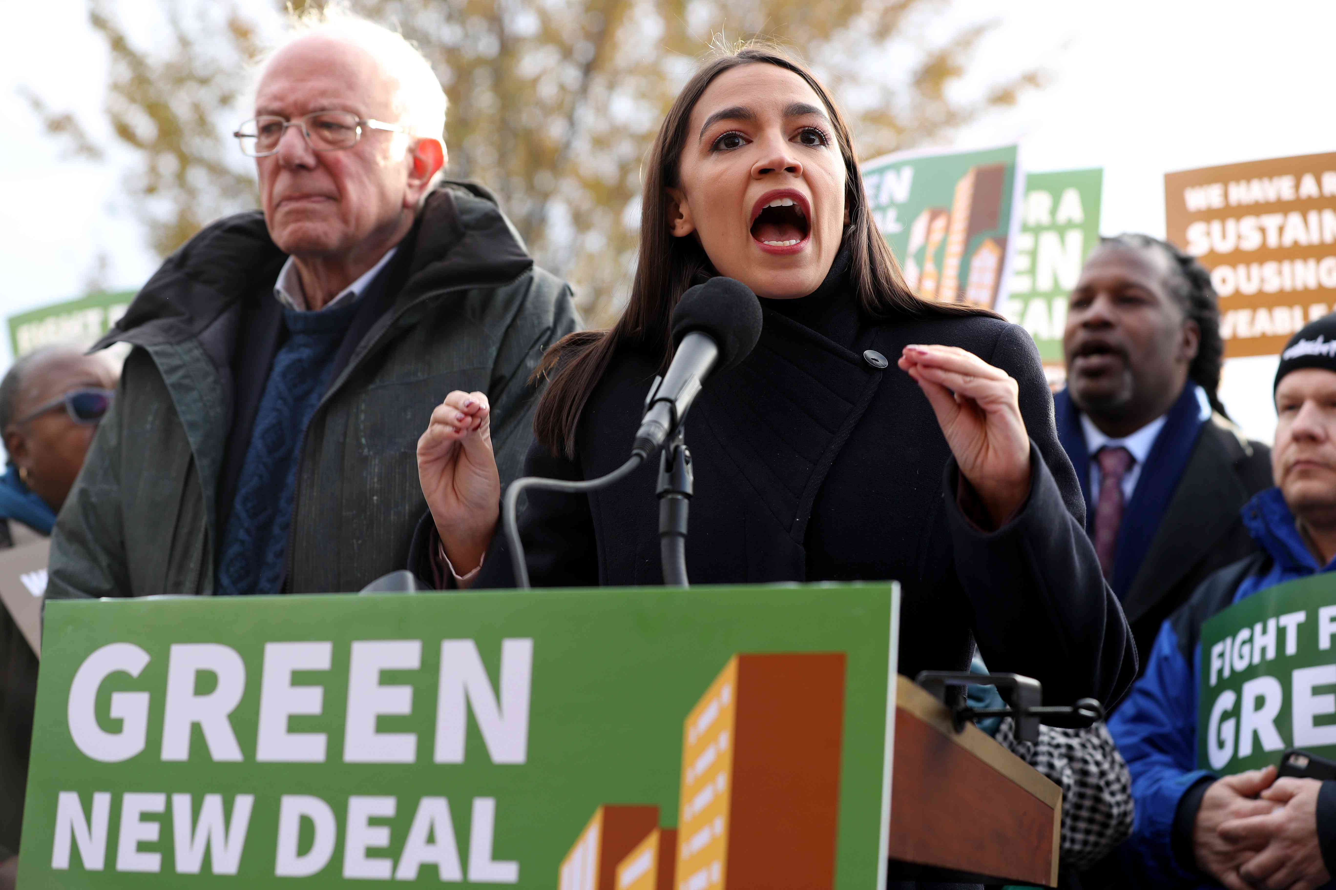 Sen. Bernie Sanders (I-VT) (L) and Rep. Alexandria Ocasio-Cortez (D-NY) hold a news conference to introduce legislation to transform public housing as part of their Green New Deal proposal on November 14, 2019 in Washington, DC.