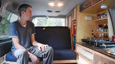 A man sitting in a converted van