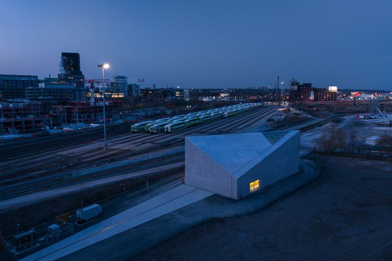 SWF building at night with rail in background